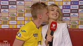 Ünlü futbolcudan kadın muhabire şok öpücük!