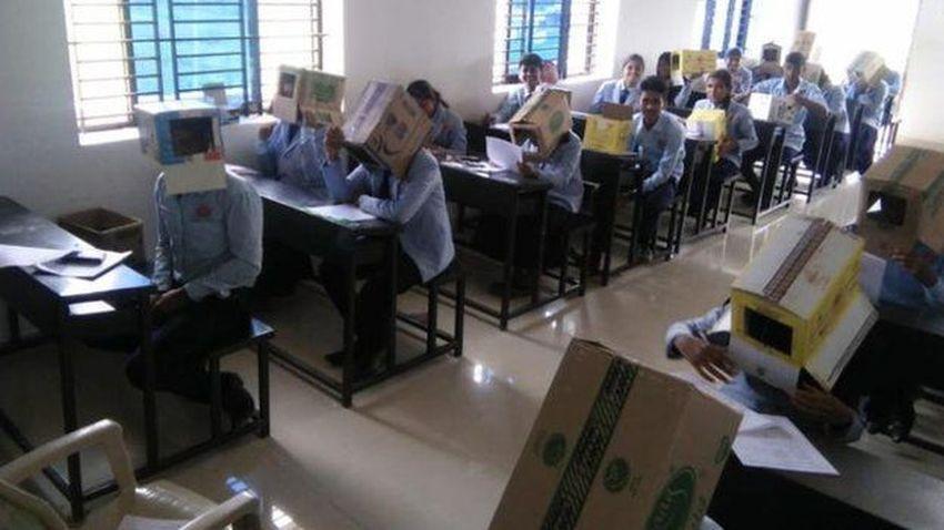 Kopyayı önlemek için öğrencilerin başına koli geçirdiler